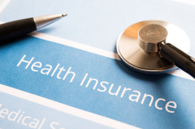 health insurance concept with stethoscope and pen